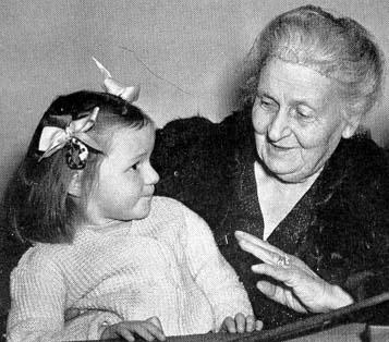 Maria Montessori with a child